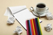 Coffee Cup And Spiral Notebook Stock Images