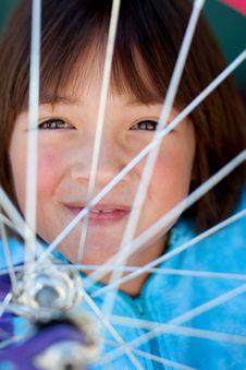 Free Girl Behind A Bike Wheel. Stock Photo - 15280760