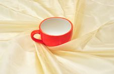 Free Red Cup At The Golden Fabric Drapery Royalty Free Stock Photo - 15281075