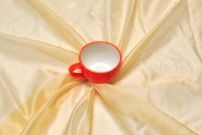 Free Red Cup At The Golden Fabric Drapery Royalty Free Stock Photos - 15281118