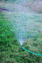 Free Sprinkler Watering The Grass Yard Royalty Free Stock Image - 15299626