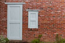 Brick Wall With Door And Window Stock Photos