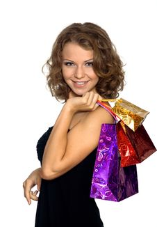 The Girl With Gift Packages Royalty Free Stock Images