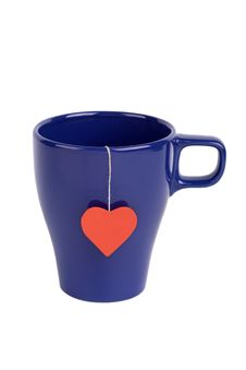 Free Tea Bag With Red Heart-shaped Label In Blue Cup Royalty Free Stock Image - 15292486