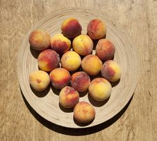 Ripe Peaches On A Plate Stock Photography