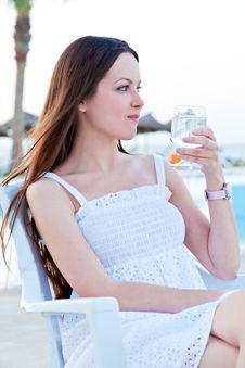 Woman With Wine Near A Pool Royalty Free Stock Photo