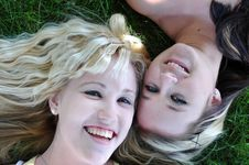 Two Girl Friends Laying In Grass Royalty Free Stock Images