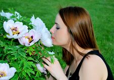 Free Girl Is Smelling Flowers Royalty Free Stock Photography - 15298737