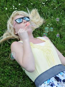 Free Girl Blowing Bubbles In Grass Royalty Free Stock Photos - 15299458