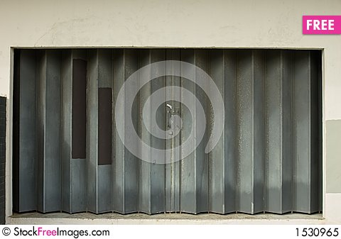 Urban Decay-sliding Metal Door With Patterns - Free Stock Images ...