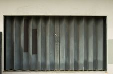Free Urban Decay-sliding Metal Door With Patterns Royalty Free Stock Photo - 1530965
