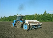 Free The Tractor Processes The Ground Under Crop. Stock Photography - 1531222