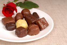 Free Variety Of Chocolates And A Rose On A White Plate Royalty Free Stock Image - 1535416
