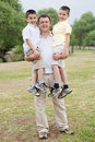 Free Father Carrying His Two Son In His Hands Royalty Free Stock Images - 15300249