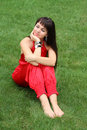 Free Brunette Girl In Red On The Grass Stock Photo - 15309660