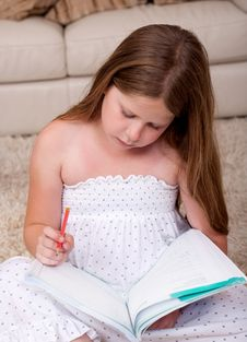 Free Young School Girl Reading Book In Living Room Stock Image - 15300311