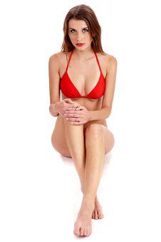 Free Young Pretty Woman In Red Bikini Sitting Royalty Free Stock Photo - 15300355