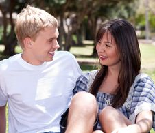 Free Young Romantic Couple Sitting Together Stock Photos - 15300363