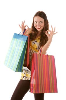 Beautiful Shopping Girl With Bags Indicating OK Si Stock Images