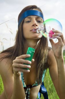 Free Hippy Blowing Soap Bubbles Royalty Free Stock Photo - 15304375