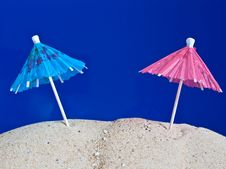 Coctail Umbrellas In The Sand Royalty Free Stock Image
