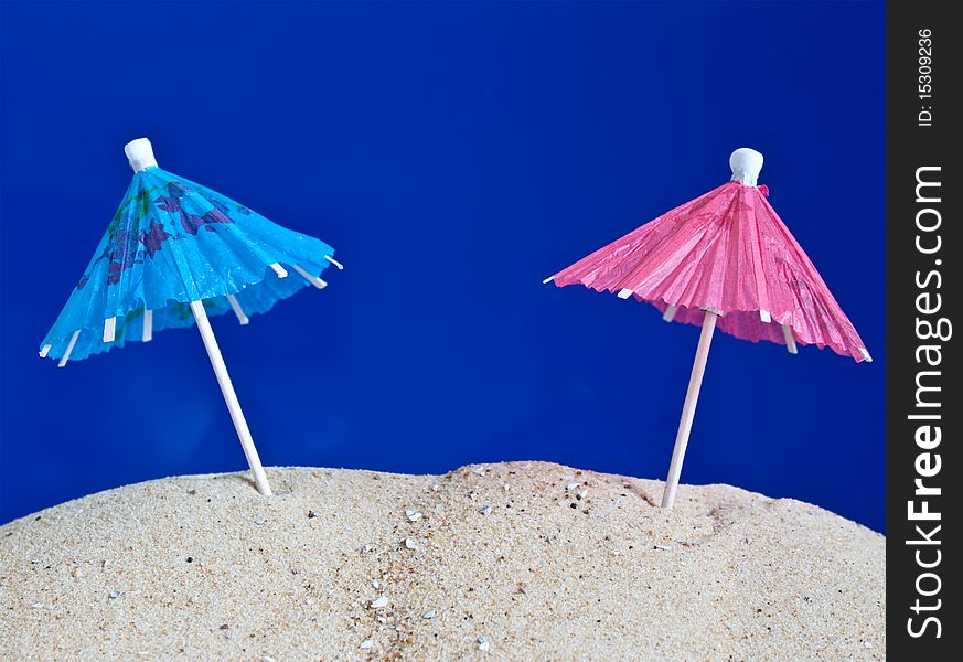 Coctail umbrellas in the sand