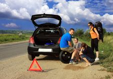 People Having A Flat Tire Royalty Free Stock Photography