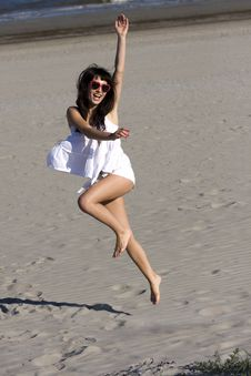 Happy Young Woman Is Dancing On The Beach Royalty Free Stock Images