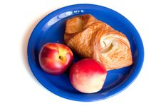 Free Croissant And Red Peaches On The Blue Plate Royalty Free Stock Images - 15311919