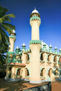 Free Minarets Of A Mosque Surrounded By Palm Leafs Royalty Free Stock Photography - 15323387