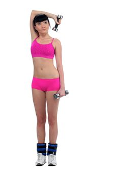 Girl With A Dumbbell Royalty Free Stock Photo