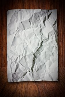 Free Blank White Crumpled Paper On Wood Wall Stock Photo - 15320850