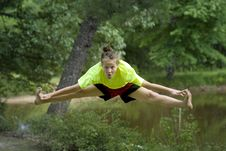 Free Girl Jumping Into Toe Touch Royalty Free Stock Image - 15325776