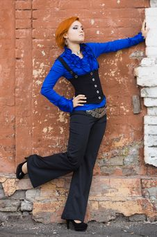 Woman Near The Wall Royalty Free Stock Image