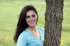 Free Young Woman Smiling Beside A Tree Royalty Free Stock Image - 15331276
