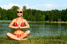 Girl In Bikini In Meditation Pose Stock Photos