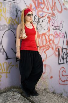 Hip-hop Styled Girl In Red Posing Royalty Free Stock Photo