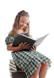 Little Girl With Pigtails Reading A Book Stock Photography