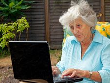 Free Elderly Lady Using Laptop Stock Images - 15338574