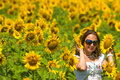 Free Beautiful Woman On Sunflower Field Royalty Free Stock Images - 15341619