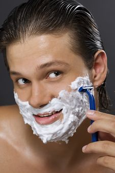 Handsome Man Shaving Stock Photography