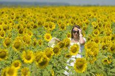 Free Beautiful Woman On Sunflower Field Stock Photography - 15341602