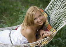 Free Beautiful Girl Smiling While Lying In A Hammock Royalty Free Stock Image - 15343486