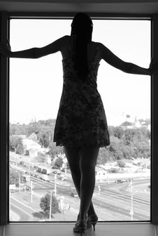 Free A Girl Standing On A Windowsill Stock Photo - 15343680