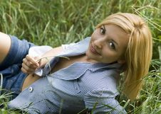 Free A Beautiful Young Girl Lying In The Grass Stock Image - 15343681