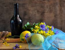 Free Still Life With A Bottle By Lemons And Flowers Stock Photo - 15344970
