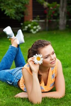 Girl With Flower On Grass Royalty Free Stock Photos