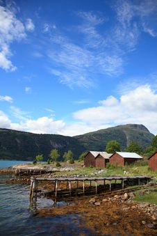 Old Wooden Pier And The Boathouses Stock Photos