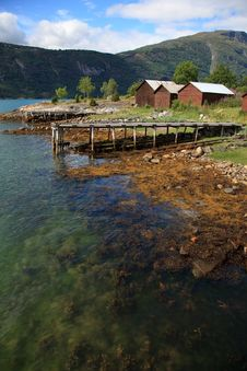 Old Wooden Pier And The Boathouses Stock Photography