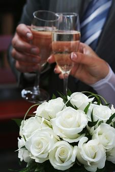 Free White Roses And Two Hands Holding Goblets. Stock Photo - 15350090